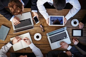 graphicstock-group-of-business-people-using-modern-gadgets-at-workplace_S8x4yq59m-